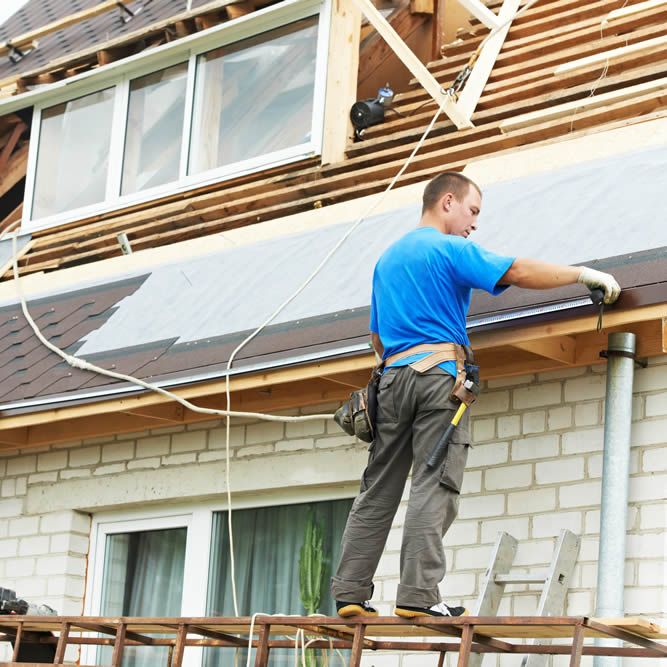 Residential Roof Installer Tied Off for Safety